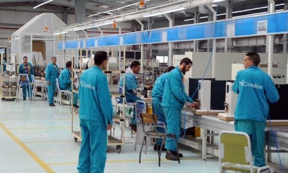 © DR   Les salariés de la société Condor dans l'usine de production